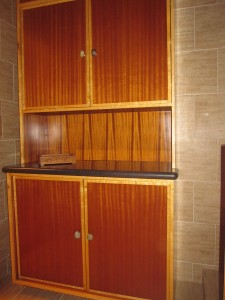Ribbon wood and beech trim  cabinet with rock door knobs