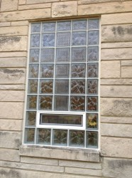 Close up of cross design in a glass block window using wave and pristal glass blocks