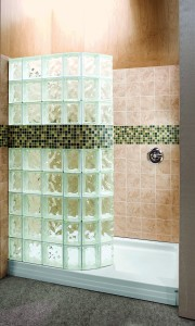 Curved 60 x 34 glass block shower with a tile row and an acrylic base