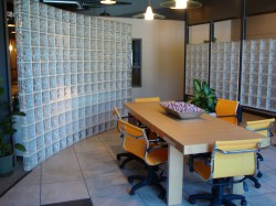 Sweeping curved conference room glass block wall