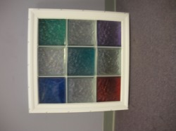colored glass blocks in a white vinyl fram
