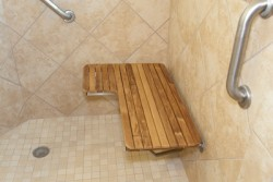 Teak shower bench seat and a decorative grab bar