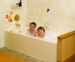 2 kids enjoying a new bathtub using an acrylic liner