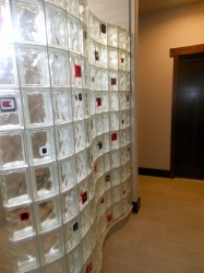 Serpentine glass block wall with glass tile blocks