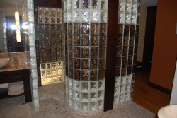Glass block walk in shower with curved and colored glass blocks