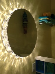 Light and mirror combination in a half bathroom
