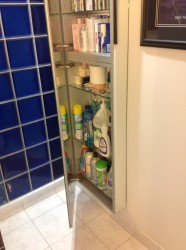 Full length mirror and medicine cabinet partially opened
