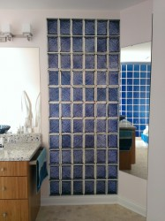 Purple privacy glass blocks separating a toilet room