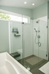High gloss shower wall panels in an arctic white color