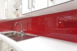 Red rouge kitchen backsplash adds a pop of color