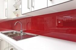Red rouge kitchen backsplash adds a pop of color