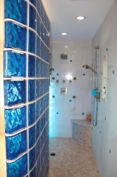 Caribbean themed blue colored glass block and tile shower