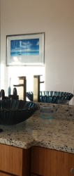 Vertrazzo recycled glass countertop and blue shell vessel sink