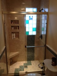 Glass tile and marble shower with colored and frosted glass blocks