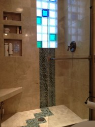 Colored and frosted glass block shower window provides privacy and lots of light!