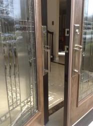 Satin nickel handleset on a fiberglass door
