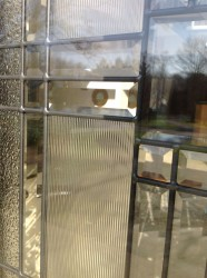 Clear beveled, ribbed and granite glass patterns in a fiberglass french door