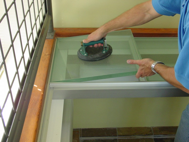 "1"" thick structural tempered glass floor with an aluminum grid support system"