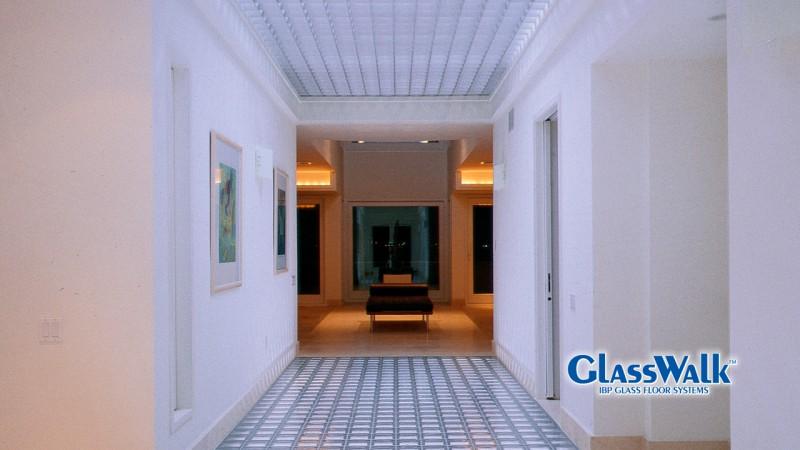 Glass block paver floor for light transmission