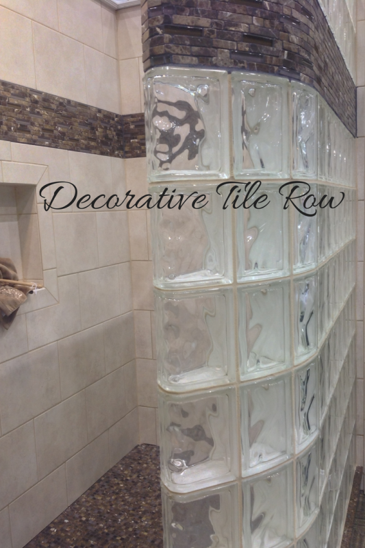 Decorative tile row in a glass block curved wall