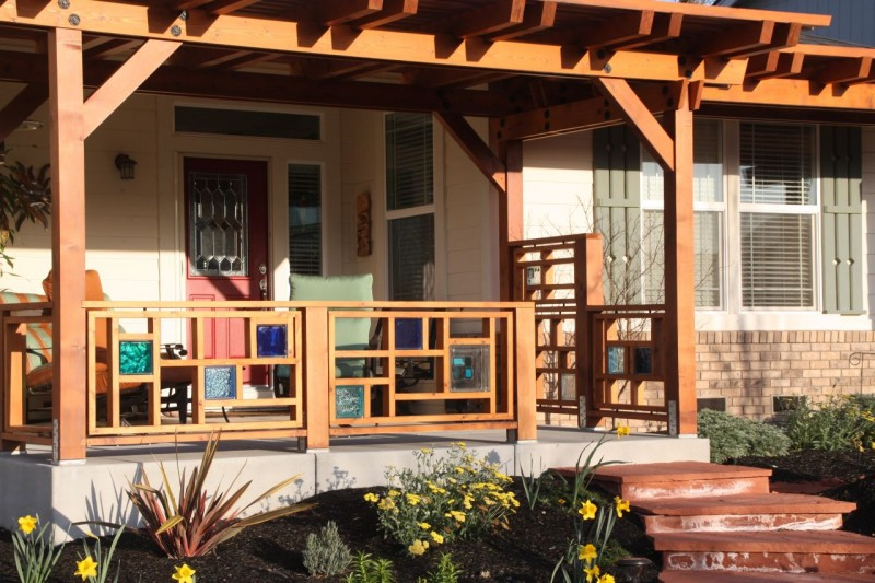 Decorative wood and glass block front porch railing