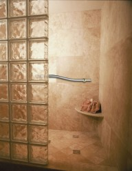 Decorative grab bar in a glass block roll in shower