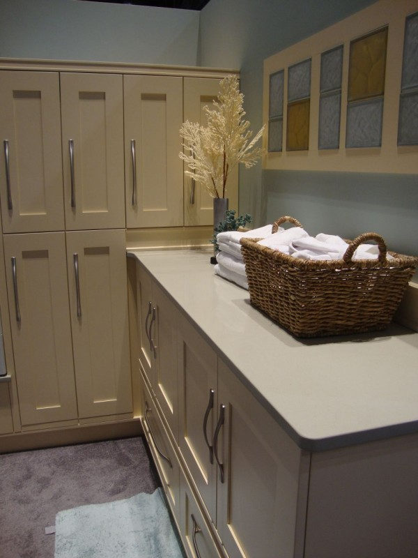 Colored and frosted glass block backsplash in a laundry room