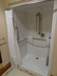 One piece roll in shower system