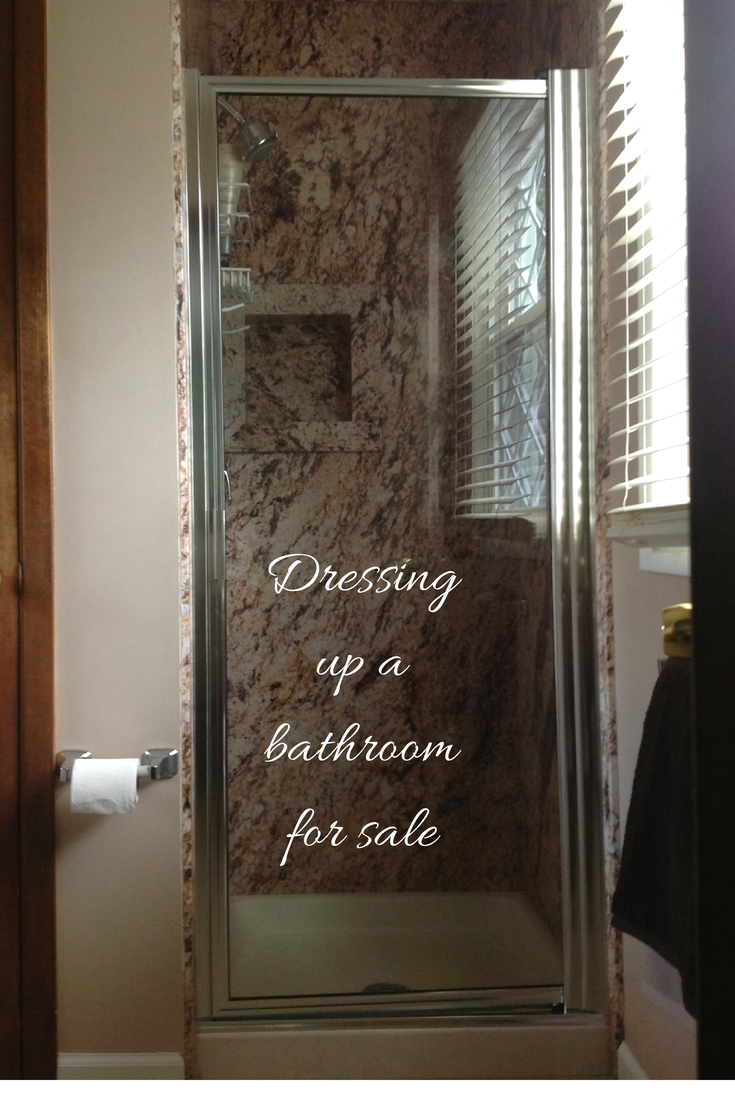 Decorative shower wall panels being used to dress up this Bath Ohio home for sale