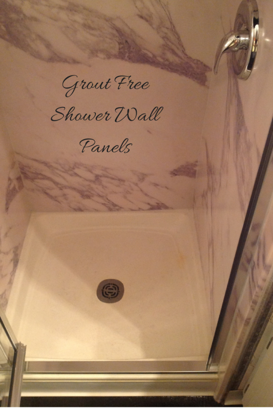 Decorative grout free stone-like shower wall panels