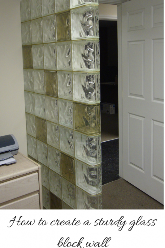Glass block wall anchored for stability