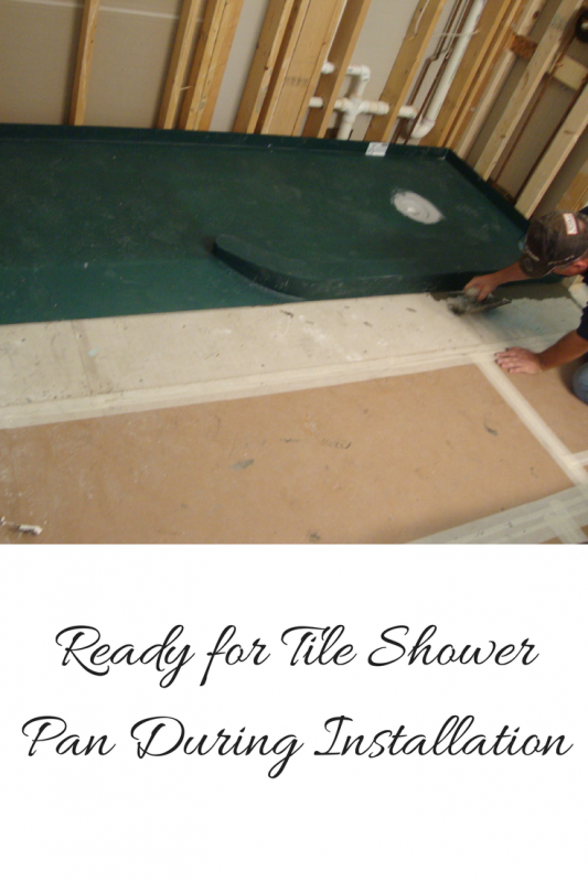 Ready for tile shower pan with custom drain location during installation process