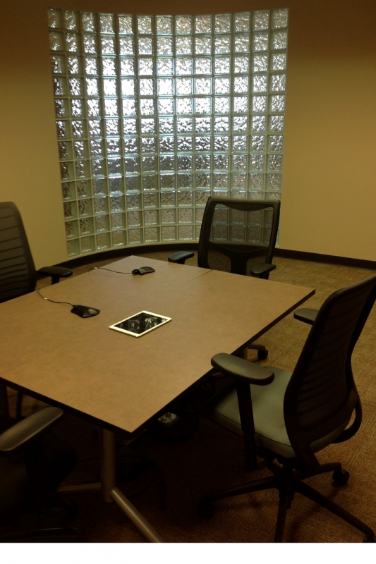 Curved glass block office wall