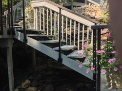 Wood stairs and railing in a Columbus landscape design