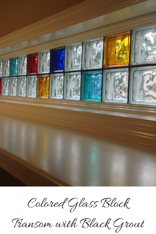 Colored glass block transom with black grout