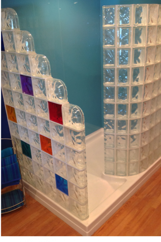 Straight and curved colored glass block walls with blue acrylic shower wall panels