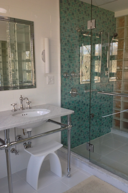 Master bathroom remodel with glass block shower and bright glass tile shower wall
