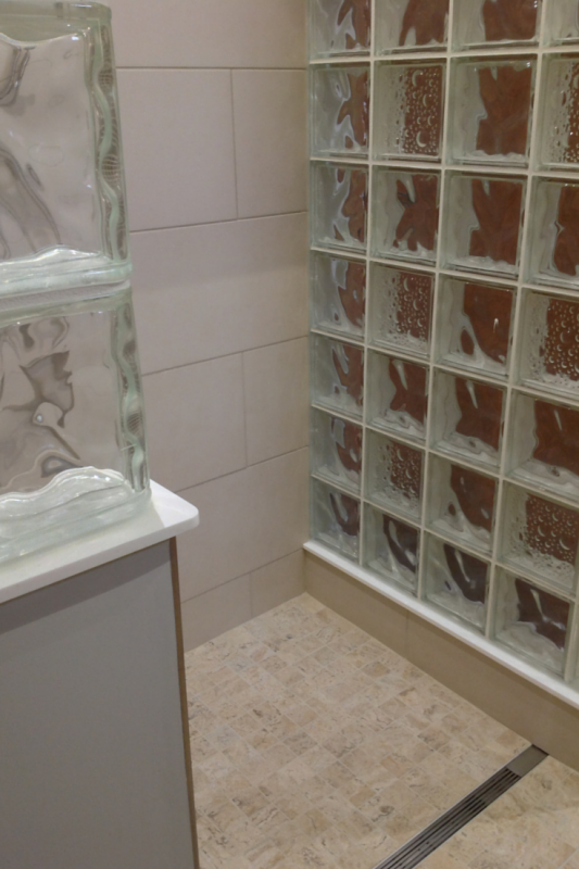 Glass block wall in an accessible bathroom Seascapes Decora Patterns