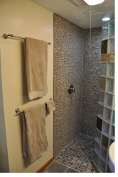 Custom fabricated shower base and glass block system