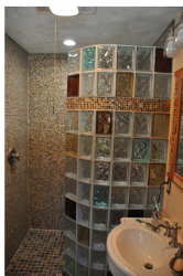 Curved glass block shower with colored blocks