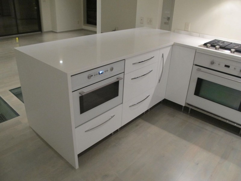 High gloss IKEA cabinetry in urban home in Kansas City