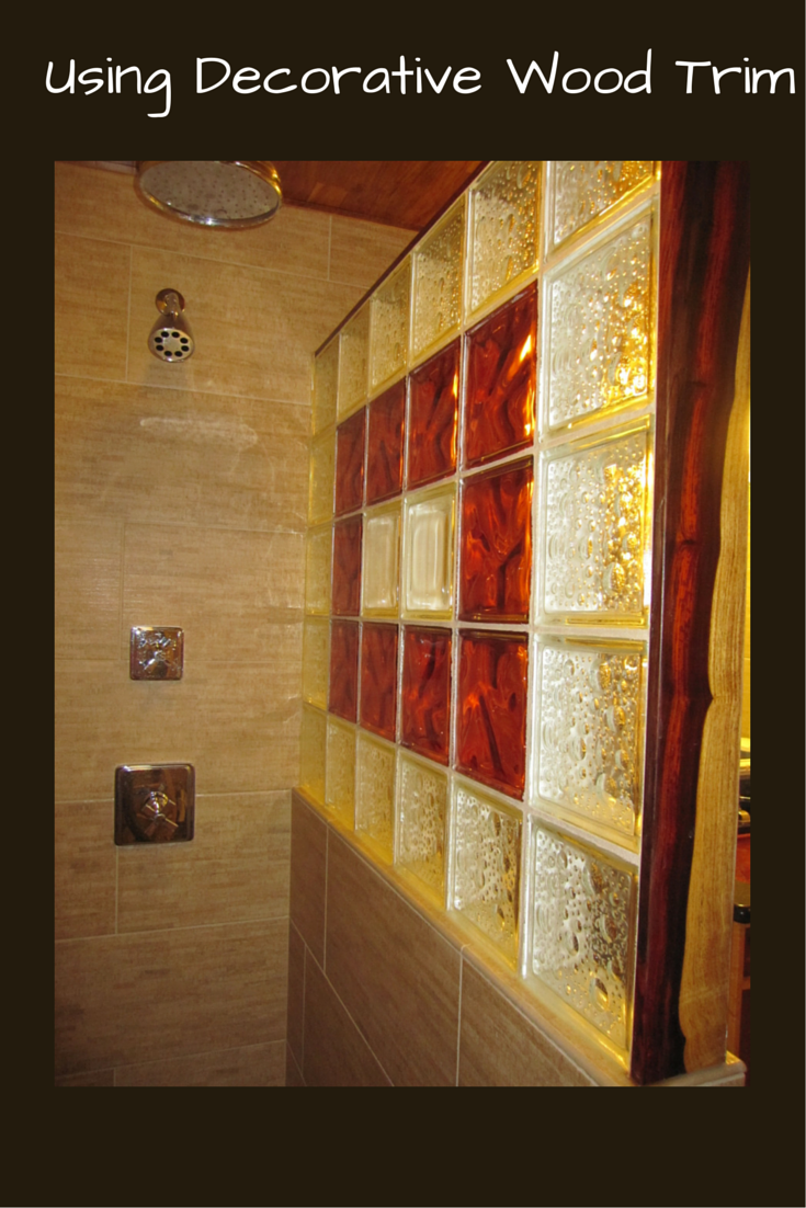 Decorative cocobolo wood trim to finish off the end of a straight glass block shower wall | Innovate Building Solutions