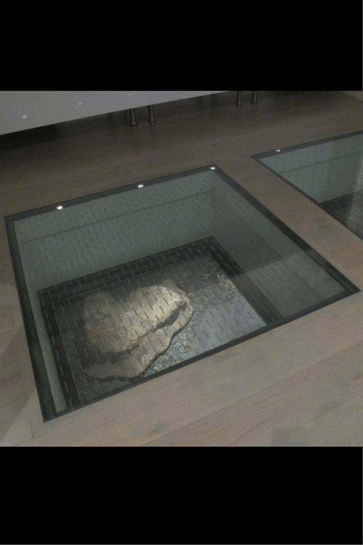 How to use glass floor panels to connect spaces in a for Floor to ceiling glass panels