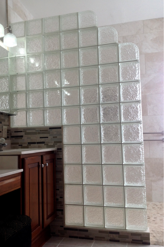 Sturdy glass block shower wall for aging in place