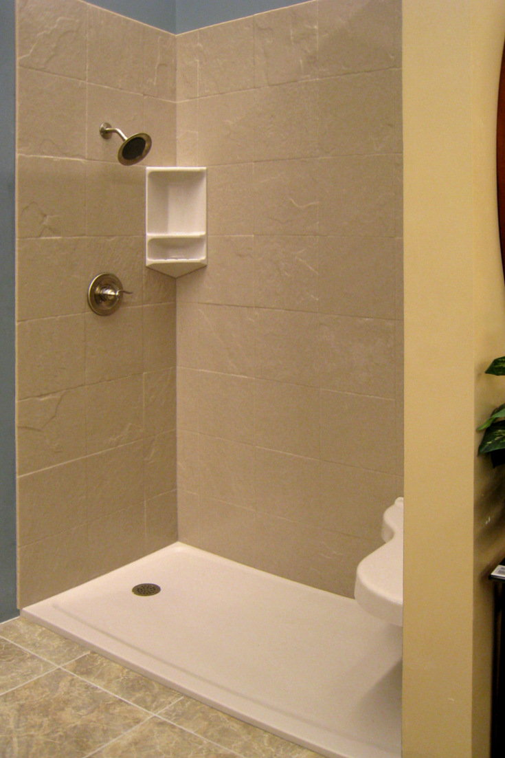 Textured bathroom walls - Stone Tile Textured Solid Surface Shower Wall Panels With A Corner Shelf