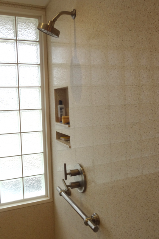 Solid surface wall panels with recessed niches for a better universal design