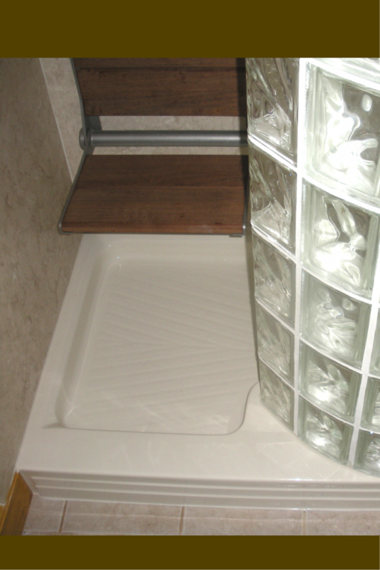Fold down seat in a glass block walk in shower