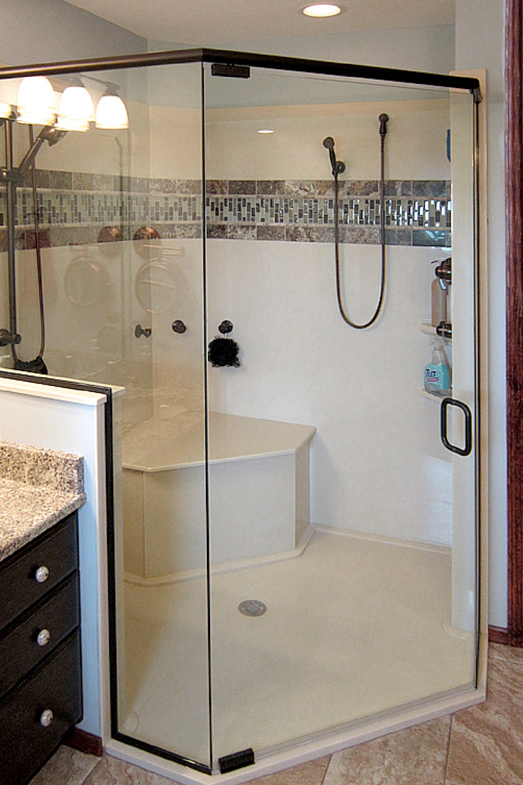 A custom angled solid surface and cultured granite shower pan | Innovate Building Solutions