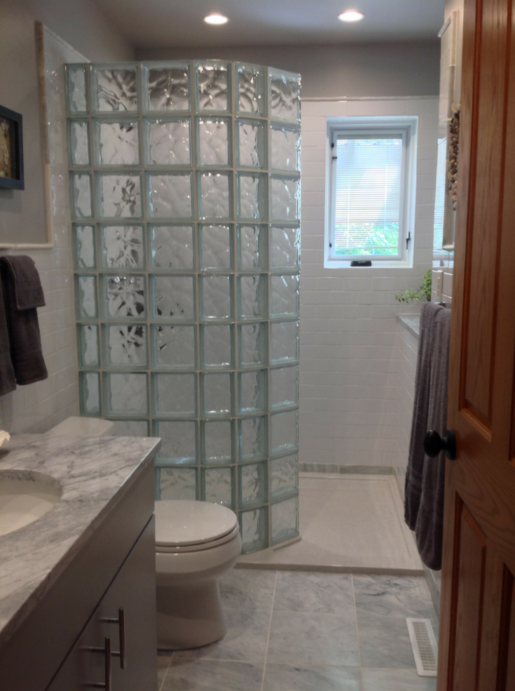 Curved glass block walk in shower wall and base in a Columbus Ohio home | Innovate Building Solutions