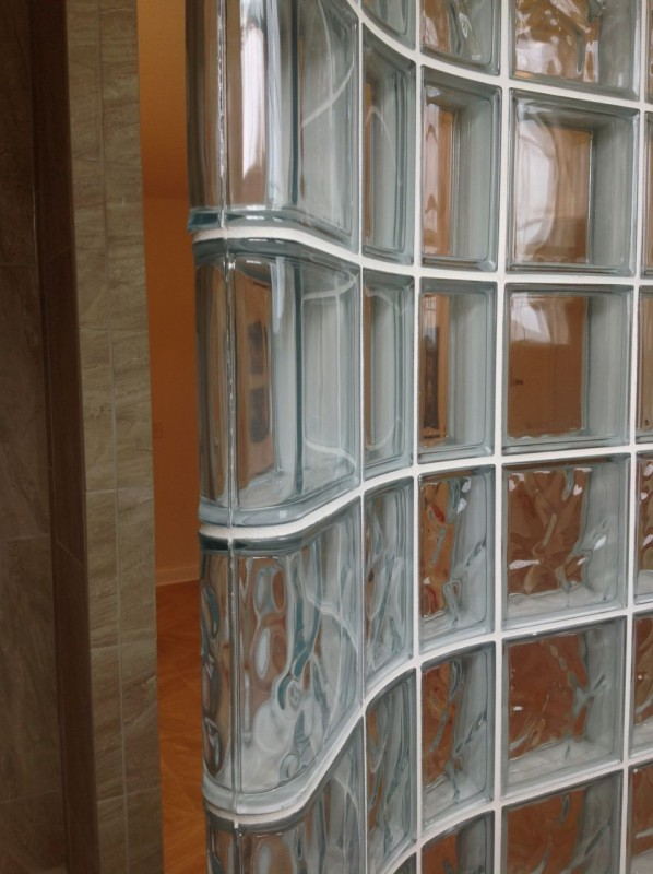 glass block shower wall with thinner curved glass blocks